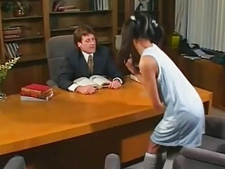 Naughty asian hottie with pigtailes gives blowjob in office