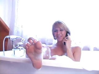 Older blonde gets her ass licked by her submissive hubby in the bubble bathroom