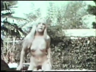 John Holmes Fucks and Facializes a Blonde Teen in a Vintage Porn Video