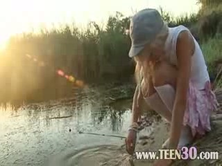 Petite 18 years old honey Loly on beach