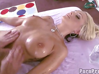 Nude busty blonde Briana Blair is oiled up from top to toe. She enjoys the massage. But her gorgeous body and big tits make guy's cock hard. Soon she finds herself getting her moist muff pounded.