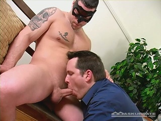 Masked tattooed stud receives blowjob by hunk