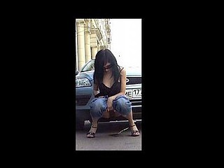 Whore shows her peeing wet crack near a car