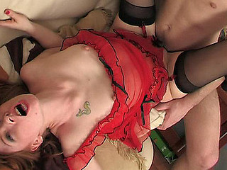 Fiery honey in full-fashioned gartered nylons gives head and gets drilled
