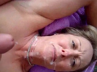 Husband gets his dick throbbing by jerking off on top of his blonde wife's face and watching her watch him! He blows his huge load all over it and gives her a full coverage facial.