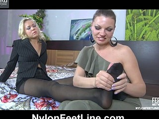 Pervy lesbo massages and sucks tired nyloned feet of her golden-haired girlfriend