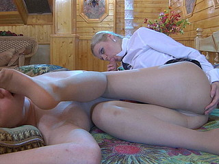 Lewd honey touches her paramour with her nyloned feet waking him up for a fuck