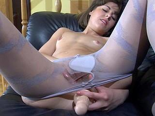Nasty girlie in blue spiral pattern hose stuffing her itchy slit hole