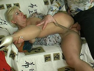 Chubby older gal lowering her silky hose to feel thrust of rocky penis