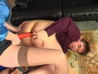 Steamy chick massaging the a-hole of her co-worker with strap-on and anal beads