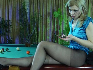 Nasty golden-haired gal flashing her constricted pantyhosed bottom in the billiard room