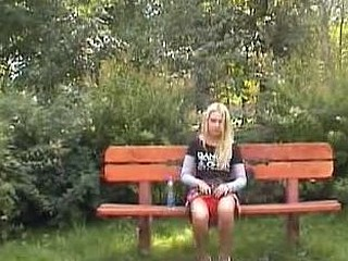 Flirty blondie piddling in the open air