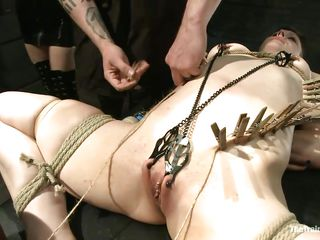 Katharine Cane is a busty brunette milf desperately in need for punishment. Watch how Soma Snakeoil and her male friend give her what she wants. The hot red haired babe and her aid are putting clothespins all over her body, making her scream with pleasure and pain while rubbing her pussy with a big vibrator.
