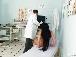 Brunette mature Magda is at her doctor for a vagina check up. Her doctor gapes that sweet shaved pussy and then uses a medical tool to gape her cunt so he can take samples after looking with attention using a flash light. We can see her insides but there's no trace of cum in there, perhaps the good old doc will take care of this problem asap.
