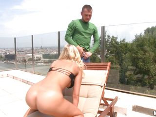 Very attractive blonde with curly hair, nice breasts and sweet ass is giving a blow job to a guy, she deepthroats wanting to feel that cock deep inside of her. He then fingers her pink cunt making it even more wet. She begins to ride the guy making her boobs jump up and won.