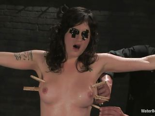 Here is Stacey, a brunette milf with nice tits, slutty face and a cunt that deserves some punishment. She is tied and her legs are spread so that a water jet can penetrate her cunt making her moan with pleasure. Her executor added a few clothespins on her body just to make things a bit more interesting.