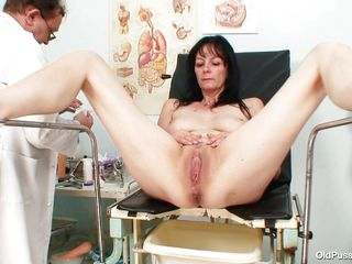 Mature brunette women with nice body and naughty breasts is sitting the gynecologist table completely naked with her legs spread so that her doctor can exam the vagina between them. He recommends her a dildo therapy so the treatment begins as he introduces that sex toy deep in her shaved vagina. She becomes horny and does treats her pussy with her own hands.