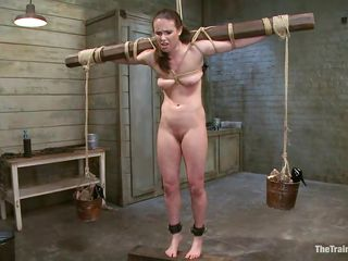 Pretty and slutty too! This is Casey and she adores being punished and fucked. The executor got her tied on a heavy wooden bar, plaid with her small tits and then rubbed that shaved, delicious cunt. She stays there with her legs spread and burst with pleasure as the man does his job. Is this bitch gonna squirt?