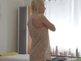 Slim blonde teen undresses and lays on the massage table. She stays there relaxed and get's oiled up. Her beautiful butt and small sweet tits excites the masseur, giving him a boner so She sees the hard dick and takes it out of his pants for some sucking. Doesn't her pink lips look nice on that big hard cock?
