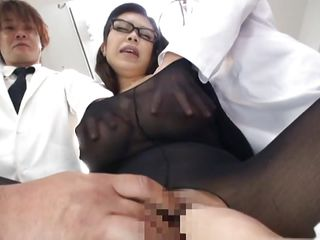 She is in the middle of attention and loves it. All those doctors are inspecting her and cut a hole between her sexy thighs to have access to her cunt. They grope her boobs and finger her pussy from behind as she gives head to one of the doc's. Want to see what kind of experiments they will do on her?