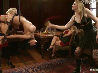 Dylan Ryan and Beretta James are two hot sex slaves that have a big history together. The blonde milf is always there to take advantage of her friend, while she is hanging on the ceiling tied up with ropes. She starts licking on her shaved pussy while the brunette gorgeous female has clothespins on her tits.