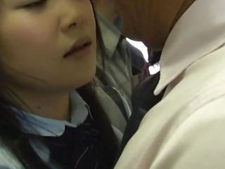 Slutty japanese college girl stays in the bus near to a handsome guy. She starts playing with that hard cock through his clothes. He touches her breasts while she brings his dick out. The bitch picks up her skirt and pushes her naughty ass on his hard penis. You think the other people will see them?