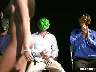 Brandi just loves to fuck while others watch her. She walks around in a room of horny guys wearing masks. She selects Mr. Frog and starts sucking his cock. She then lays back and spreads wide to take it deep before climbing aboard and riding his stiff willy all the way down, every inch within her.