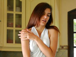 Because she is a hot girl and doesn't knows much about cooking she does what she knows best, spreading her legs and shows us her tight pussy. This skinny teen with long sexy legs, cute titties and a pretty face knows that we are watching her and she does her best to make us horny. Is she going to insert something big in her hot tight vagina?
