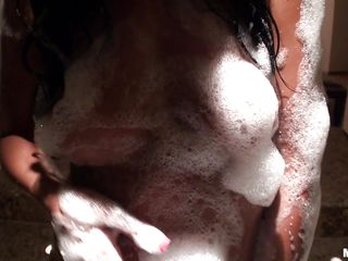 There is something very sexy about a wet, black haired girl. This girl has slicked her body by applying soap and developing lather all over her body. Way she rubs her booty and her boobs and fingers her ass is enough to turn on a mummy who has been dead five thousand years.