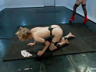 Mz Berlin got her paws on a pony tails blonde cutie. She is gonna delight herself with this young slut and make and obedient sex slave out of her with the help of electricity. Penny has electrodes all over her thin white body and Berlin enjoys tormenting her. Surely the fun just began so don't miss it!