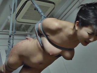 The executor didn't just humiliated this brunette Nippon milf, he brooked her self esteem and no she accepts her fate. She hangs there and then she is lowered only to stay in cowgirl position. After some more humiliation she receives a hardcore fuck from behind that makes her pretty mouth moan and her boobs bounce