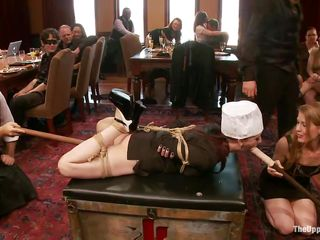 Slave girl is tied on the table at a sex party, while the other people are taking advantage of her and laughing. She has dildos in both her dirty mouth and filthy cunt. The bitch is very thankful for this treatment and enjoys having her ass spanked by other horny whore at the same time. Check this out!