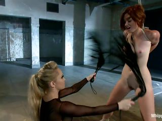 We love seeing a cutie whipped and punished but all that is performed by a sexy dominating milf, things are lot more hotter. Look at that cute slut, she has delicious titties that have been whipped and clamps were putted on them, a perfect ass which the mistress loves to punish and a face that truly deserves a few slaps!