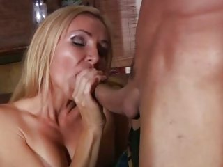 MILF Lisa Lee sucks and tit fucks cock before a fuck