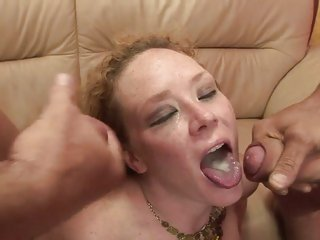 Saucy redhead Audrey Hollander gets a mouth full of cum