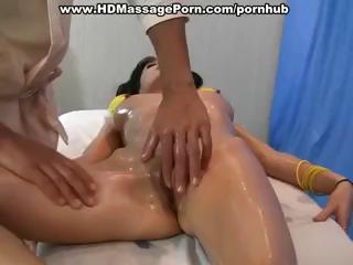 Hot brunette receives oiled up for a nice massage and receives fucked